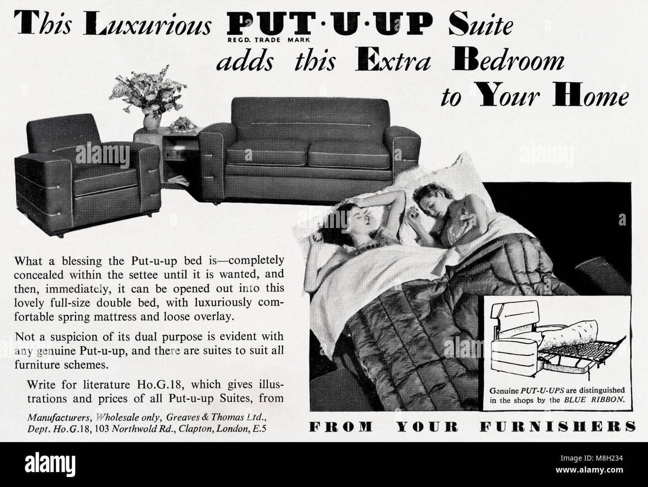 1950s original old vintage advertisement advertising Put U Up suite sofa bed in English publication circa 1950 - Stock Image
