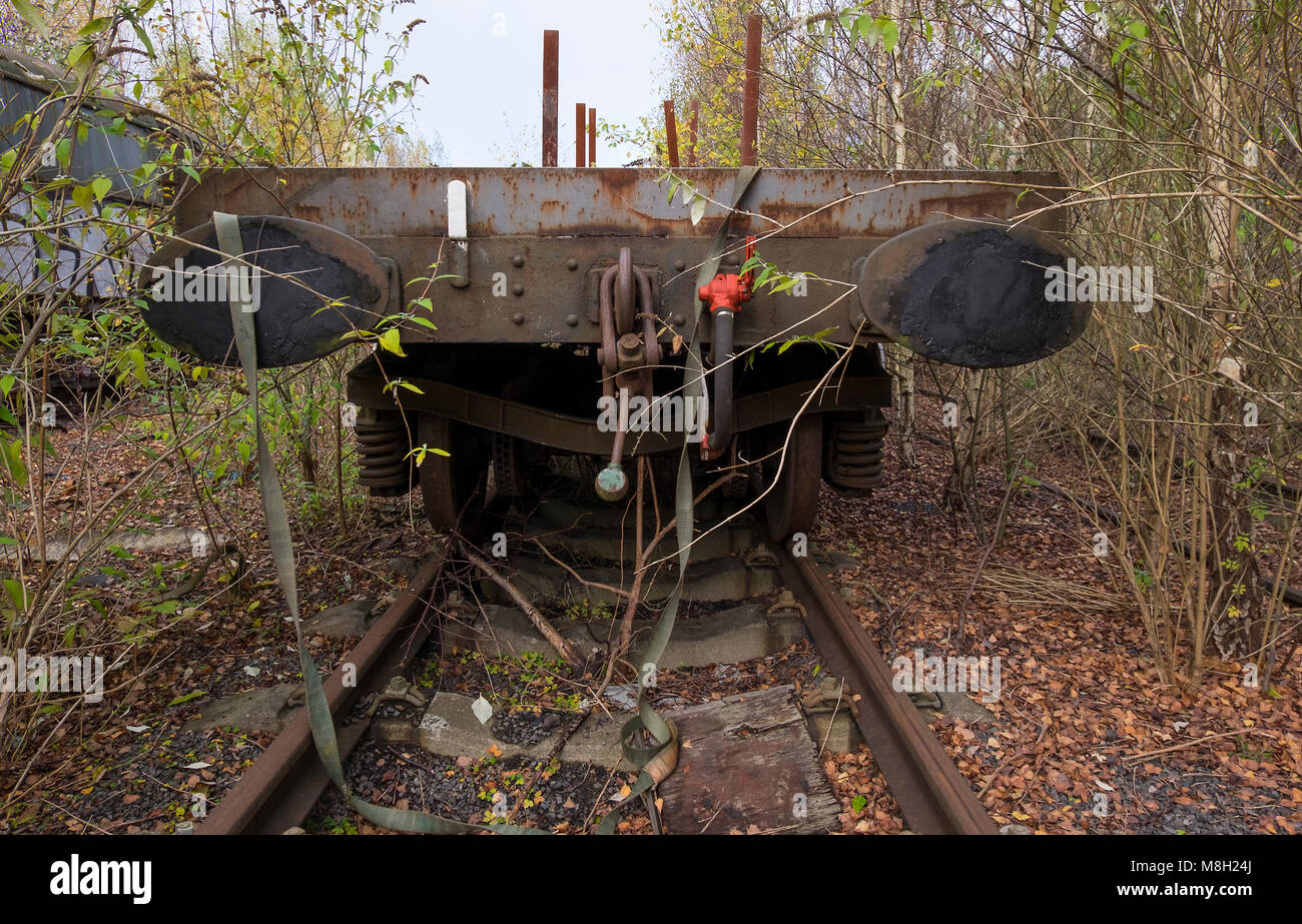 Abandoned flatbed railroad wagon - Stock Image