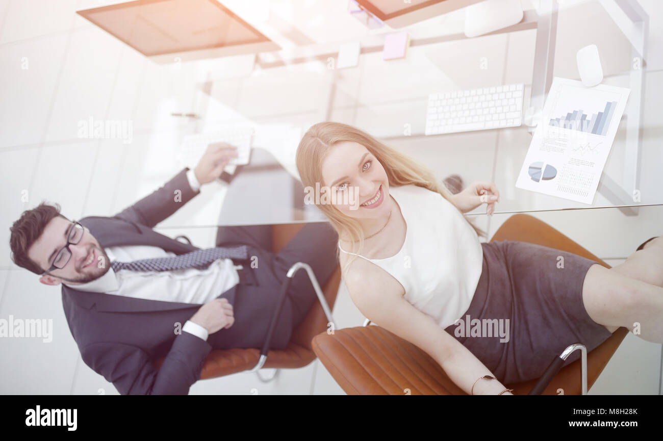 business people sitting at office desk in office. top view - Stock Image