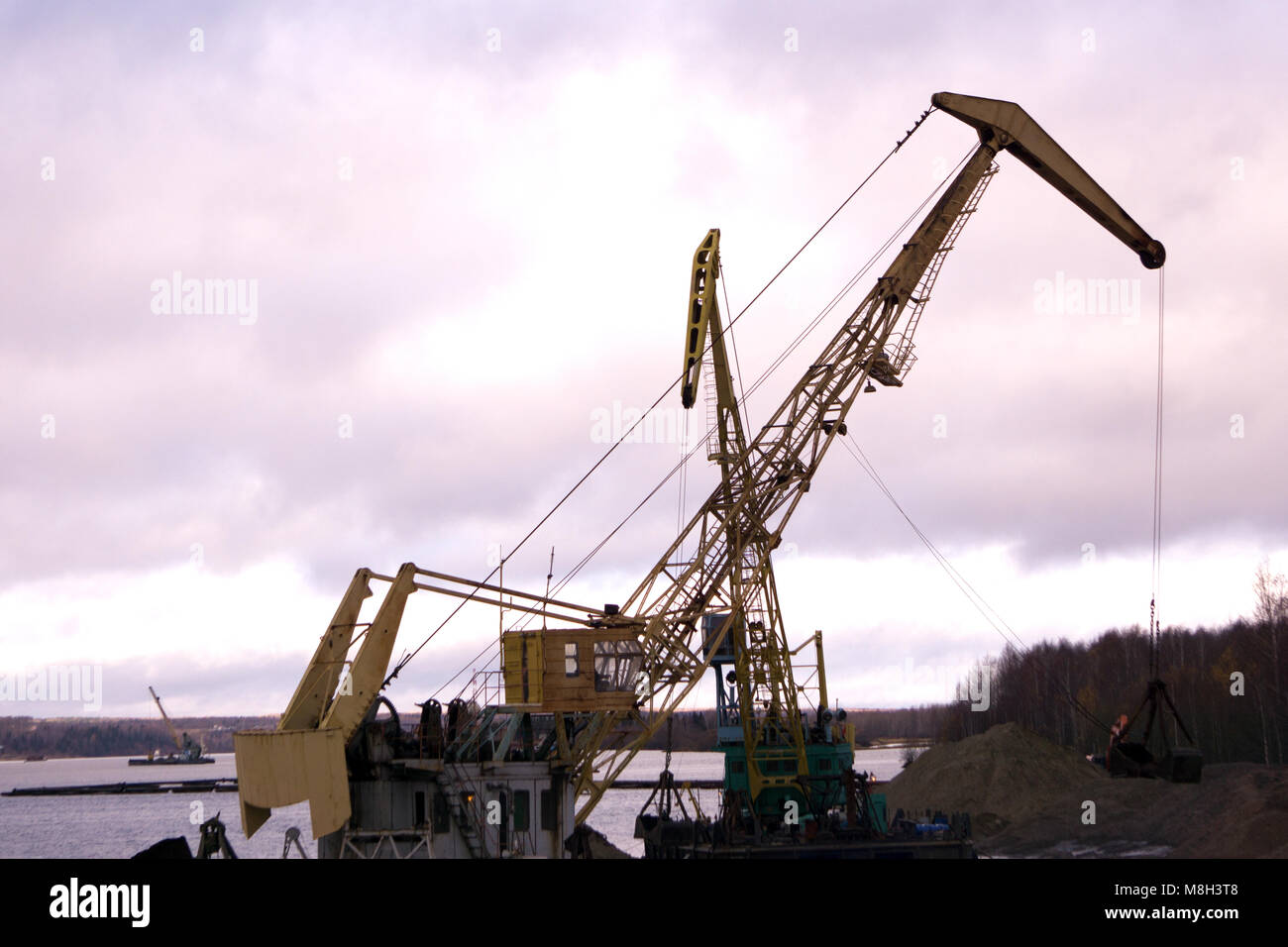 Large industrial tower car floating crane tower . - Stock Image