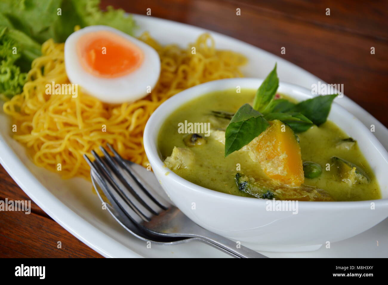 chicken curry and egg noodle - Stock Image
