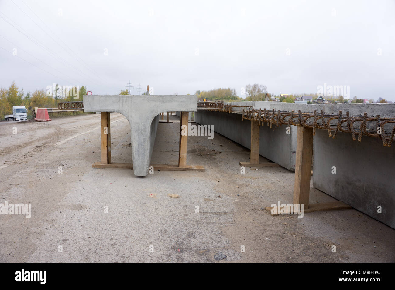 A gap in the concrete bridge ad a symbol of risk and danger - Stock Image