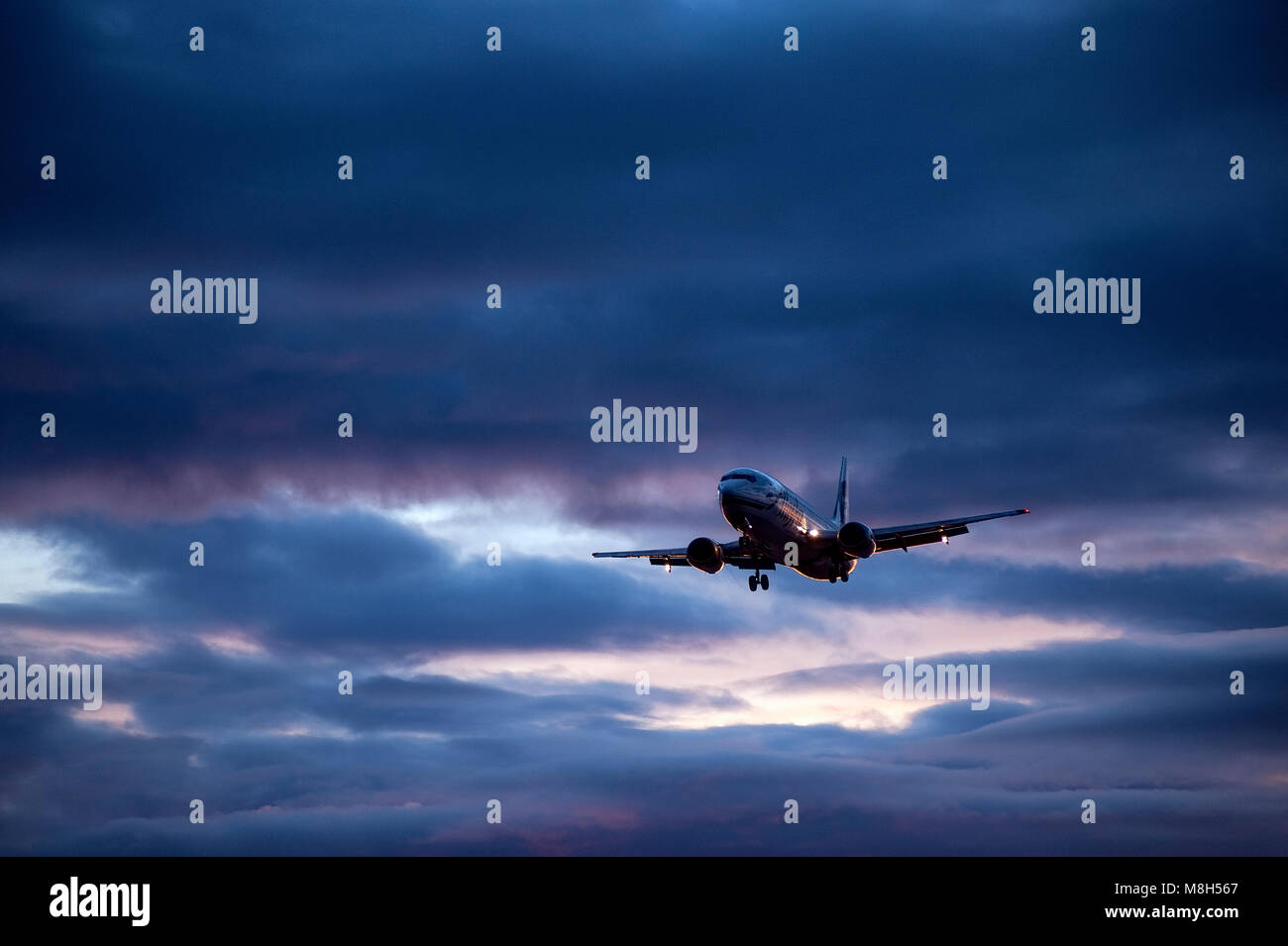 Alaska Airlines jet airlpane in flight, Alaska, USA. - Stock Image