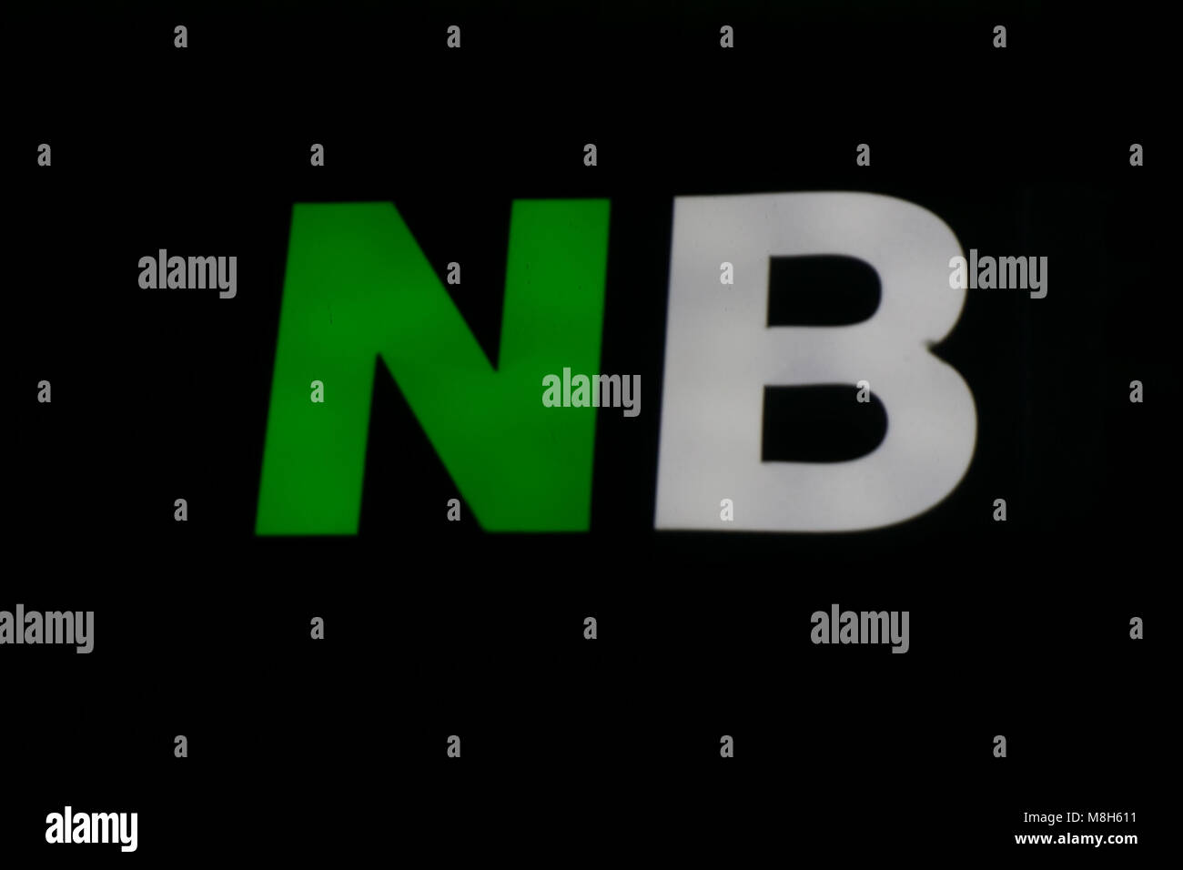 the letters NB white and green . - Stock Image