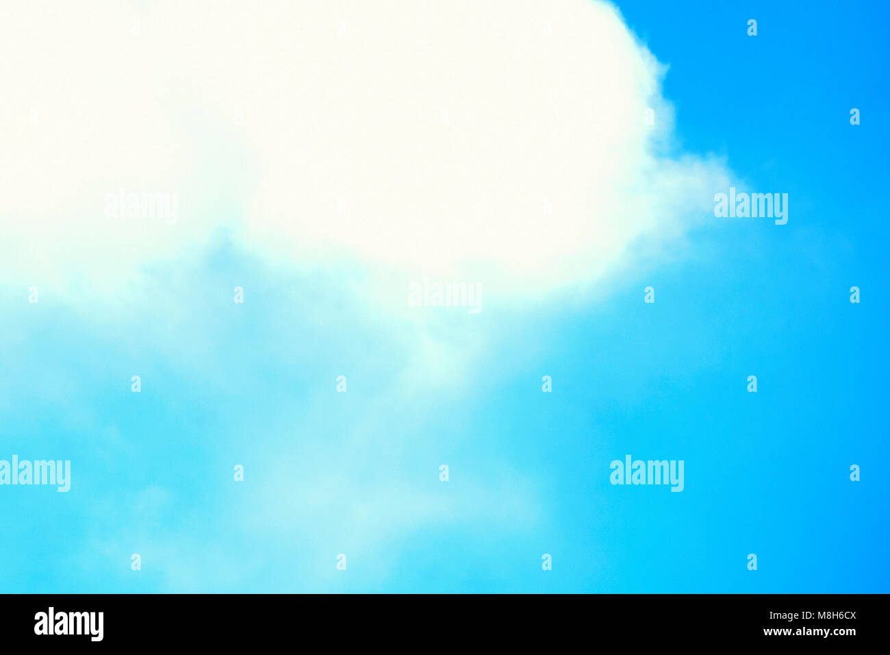 Air clouds in the blue sky - Stock Image