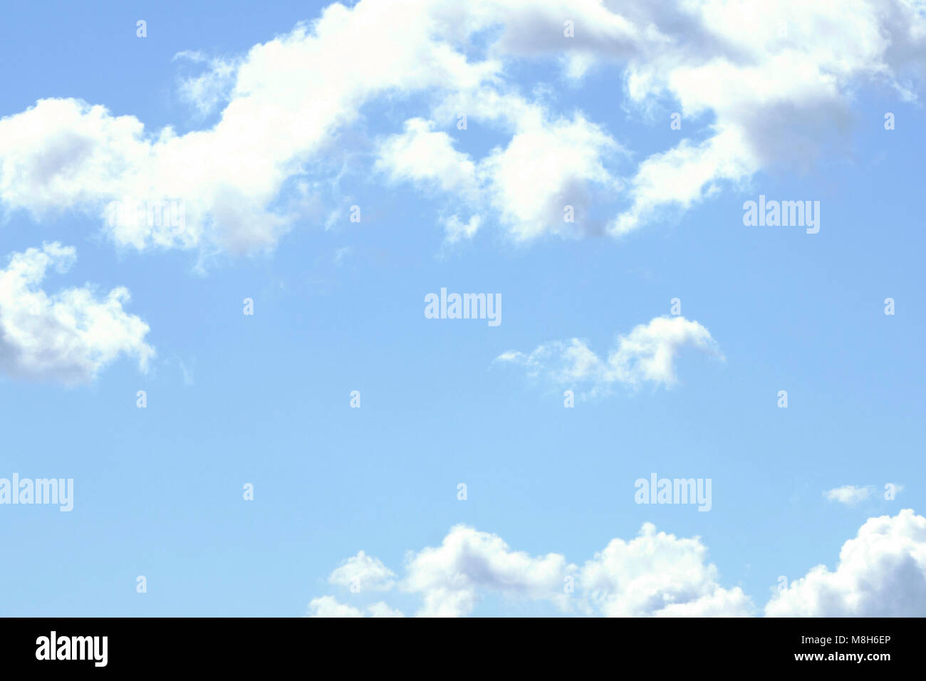 at sunset with an infinite horizon and smooth clouds in a pale blue color tone - Stock Image