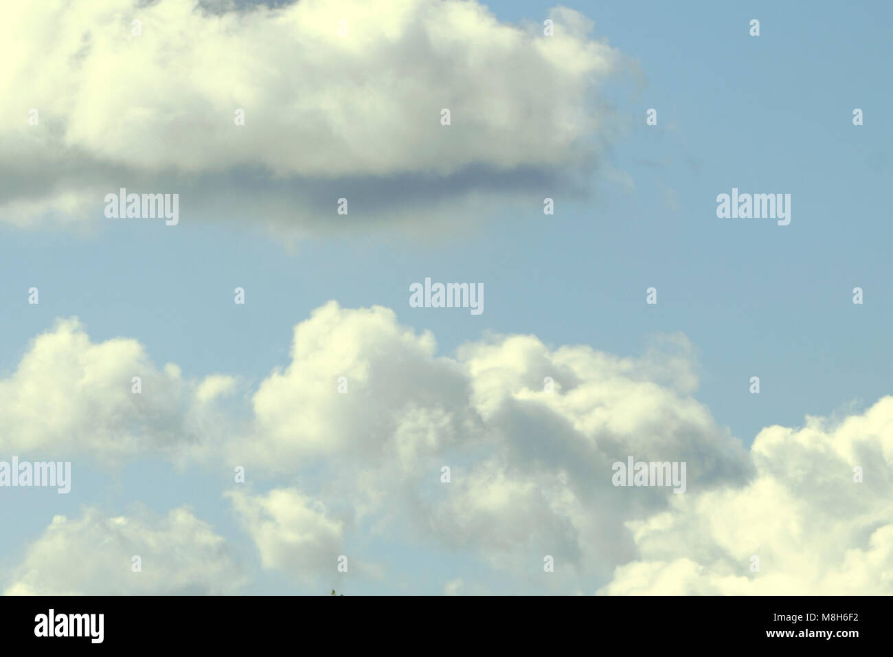 background of blue sky with few clouds - Stock Image
