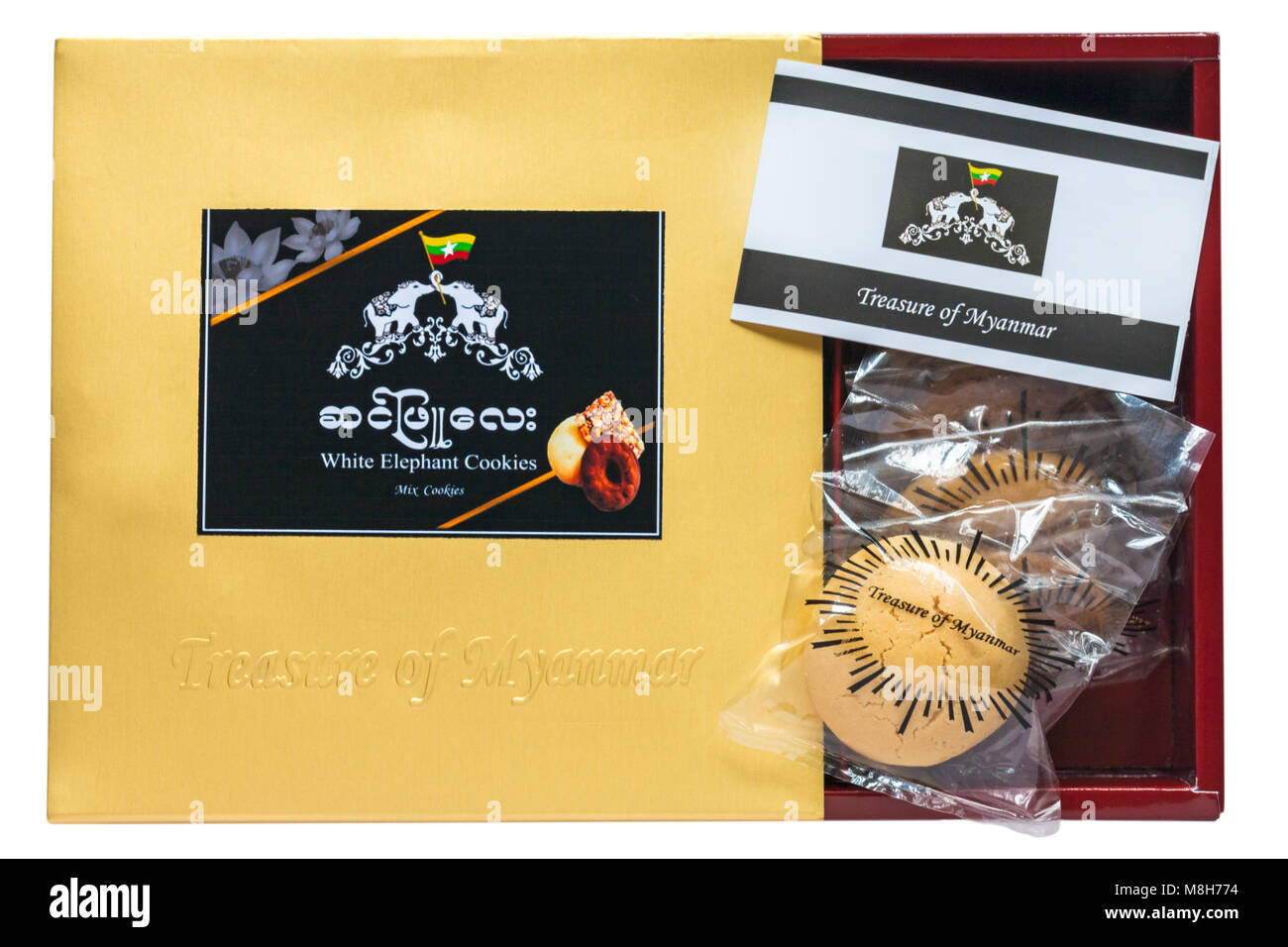 Box of Treasure of Myanmar white elephant cookies opened to show contents set on white background Stock Photo