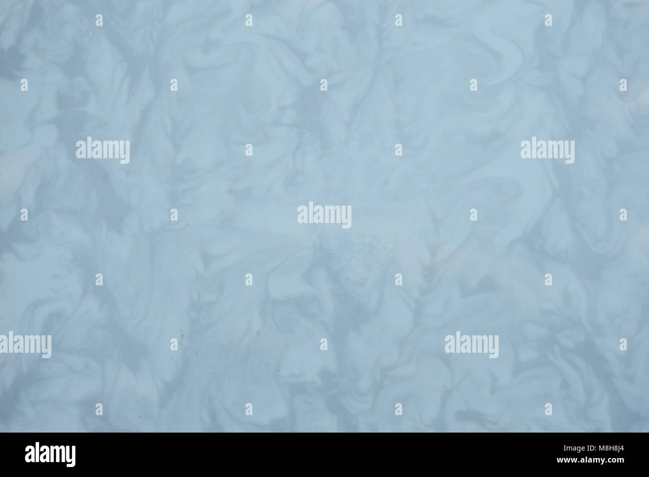 gray vintage paper with large and small divorces, spots - Stock Image