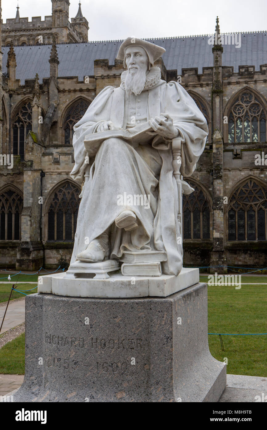 A statue of Richard Hooker near Exeter Cathedral. - Stock Image