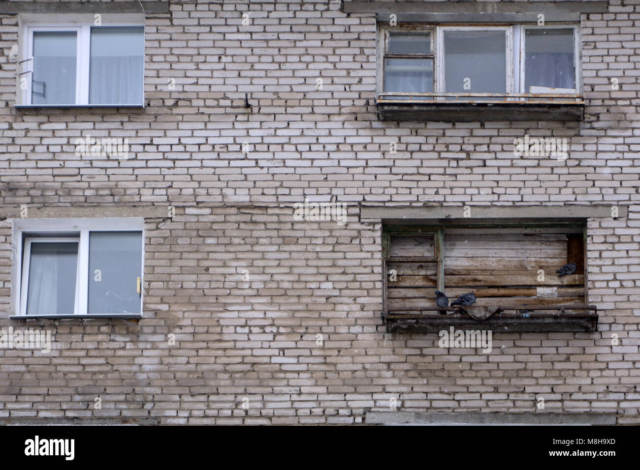 room in an old house with boarded up window - Stock Image