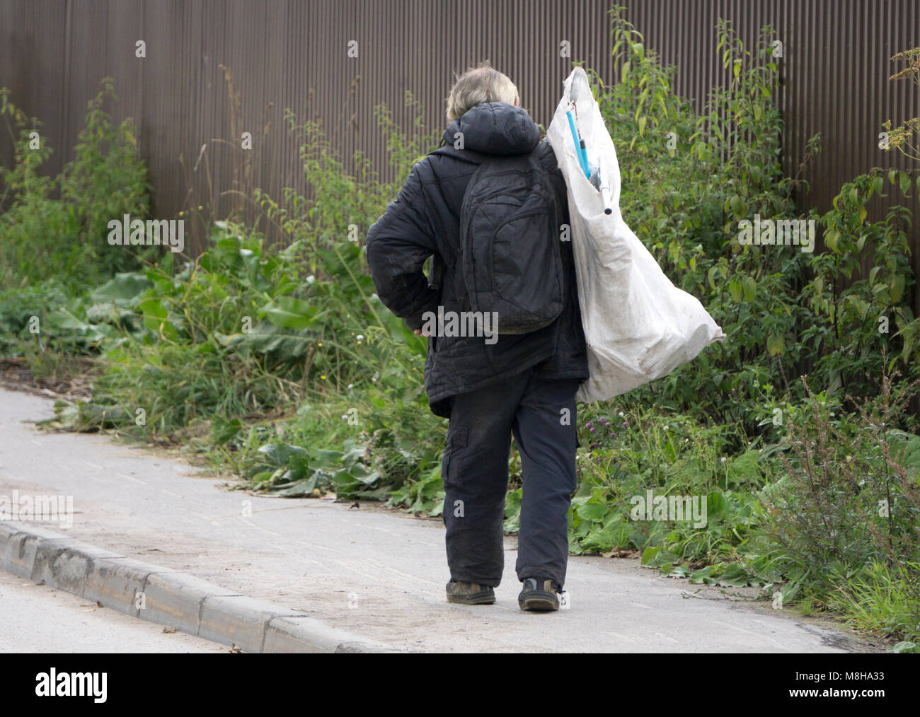 Neglectful man throwing out the garbage in the forest - Stock Image