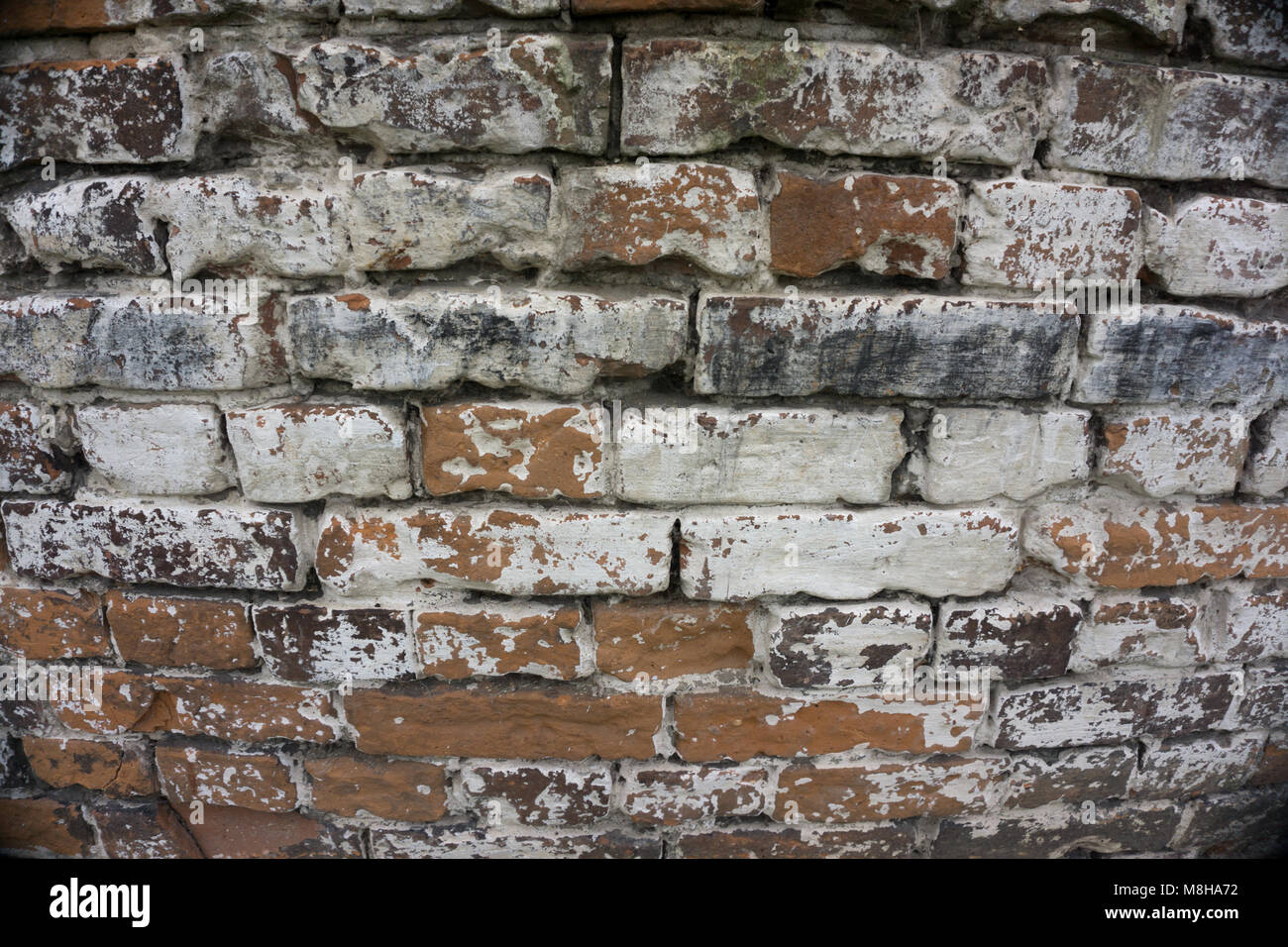 Cracked Dark Red Old Brick Wall Texture. Damaged Brown Abstract Blank Stonewall Background. Ruinous Brickwall Dilapidation - Stock Image
