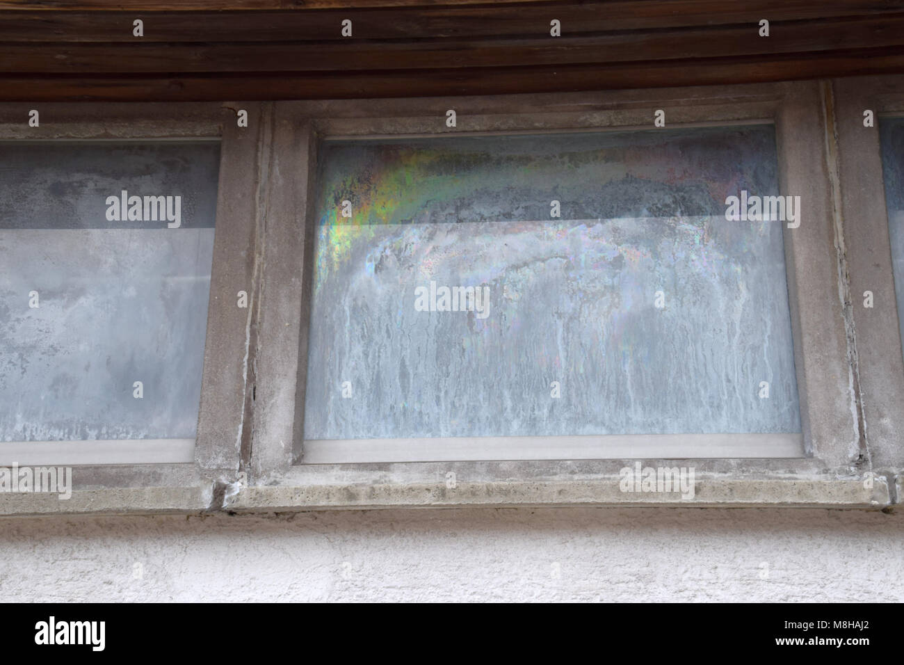 stolidly old window, window with fogged and dull - Stock Image