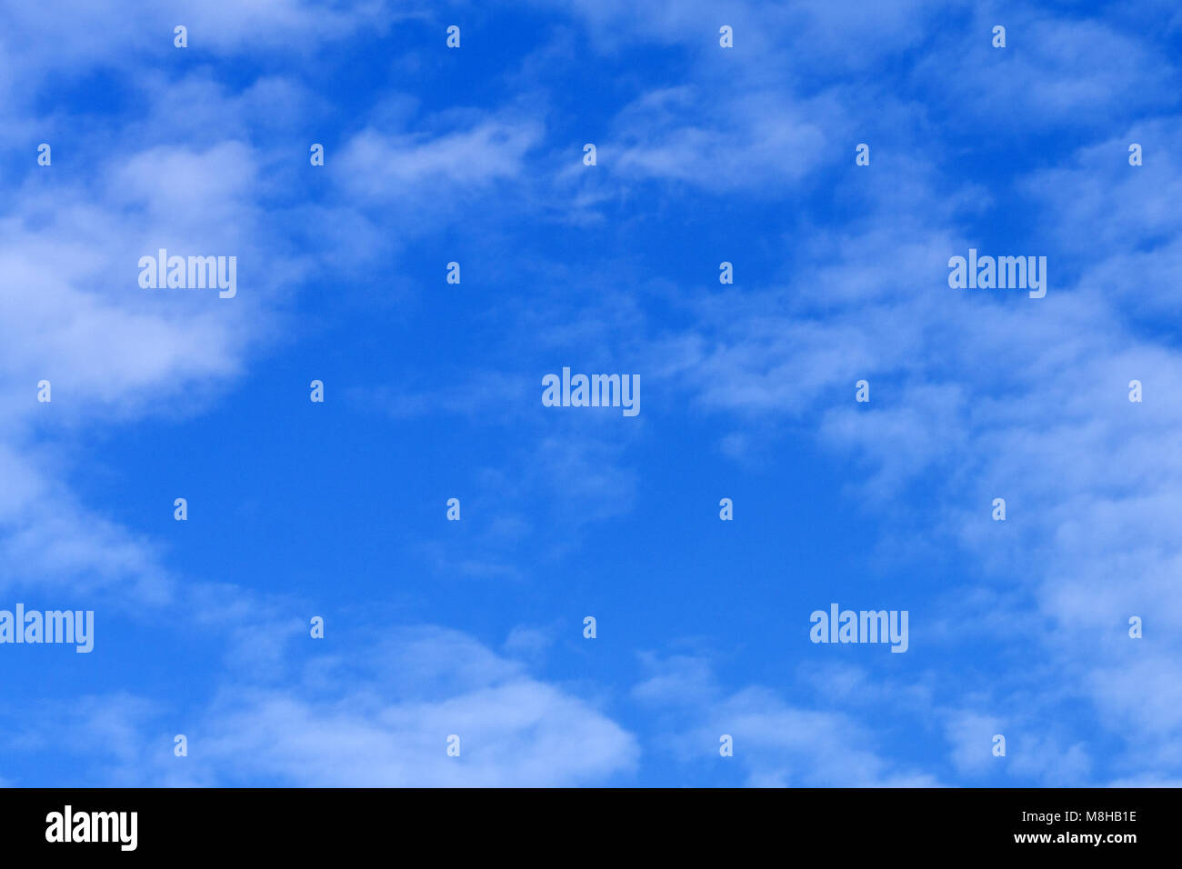 High resolution photo of cumulus clouds against a blur sky. Great background image for composites - Stock Image