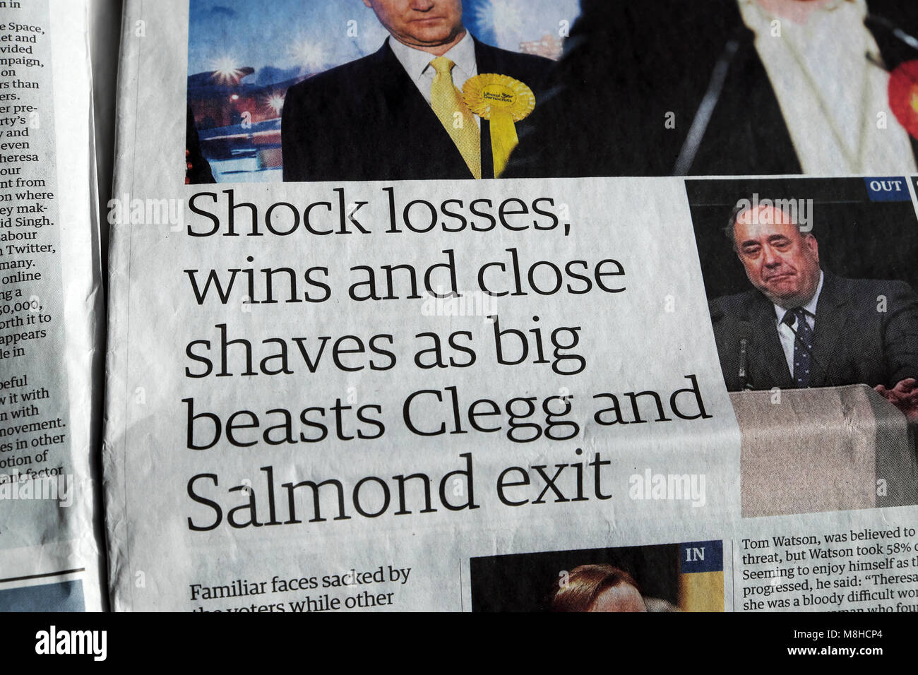 'Shock losses, wins and close shaves as big beasts Clegg and Salmond exit' article in the Guardian newspaper - Stock Image