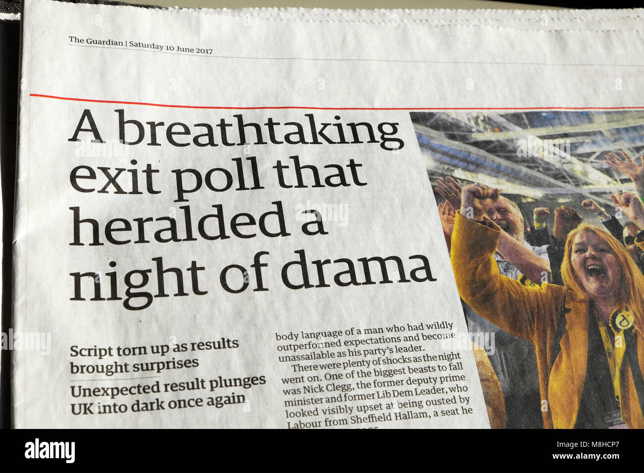 Guardian newspaper article 'A breathtaking exit poll that heralded a night of drama'  2017 election results - Stock Image