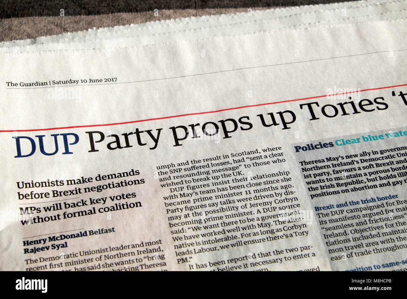 'DUP Party props up Tories 'to bring stability' 'Guardian newspaper   headline article 10 June 2017 - Stock Image