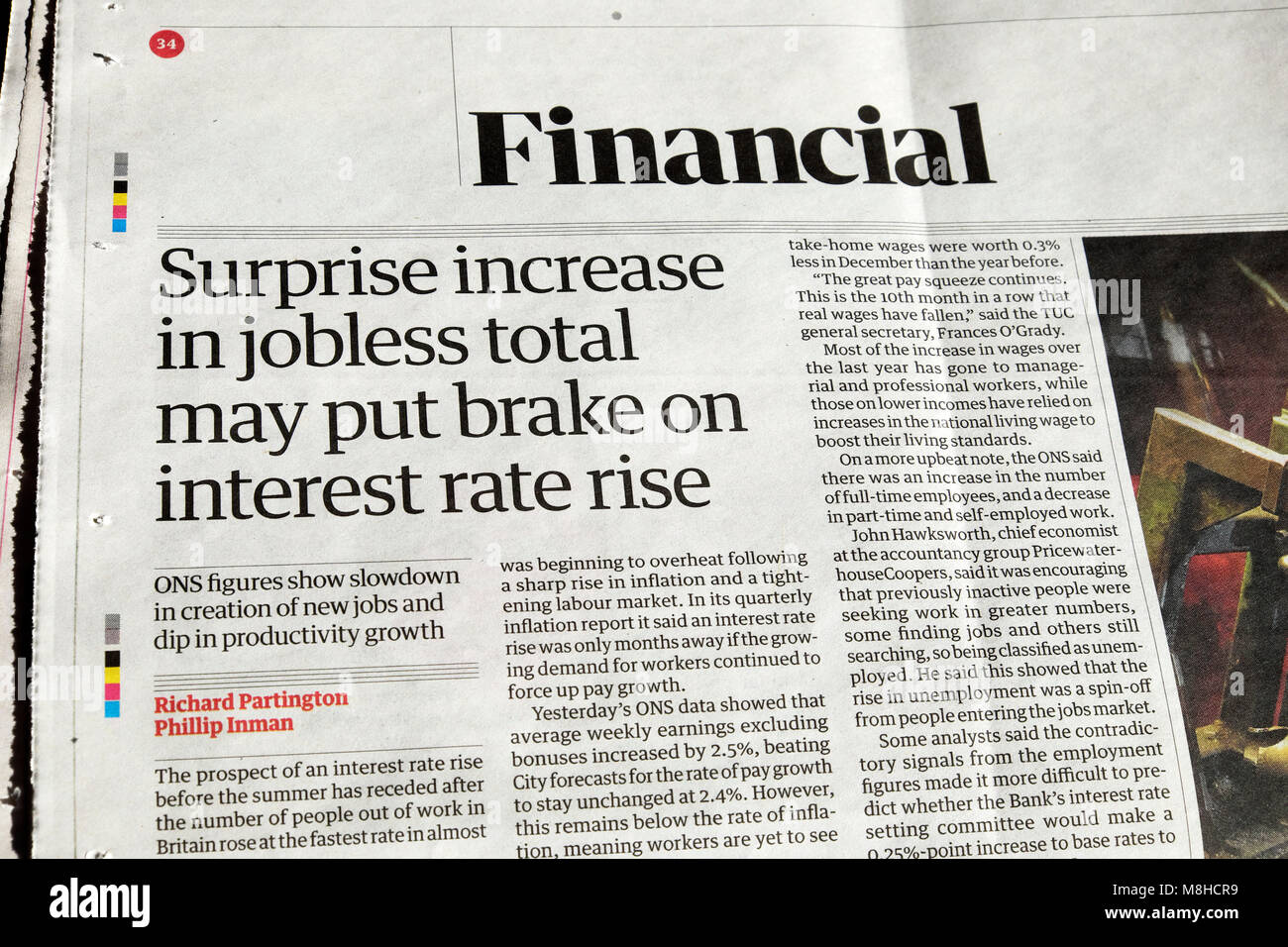 Guardian newspaper article Financial headline  'Surprise increase in jobless total may put brake on interest - Stock Image