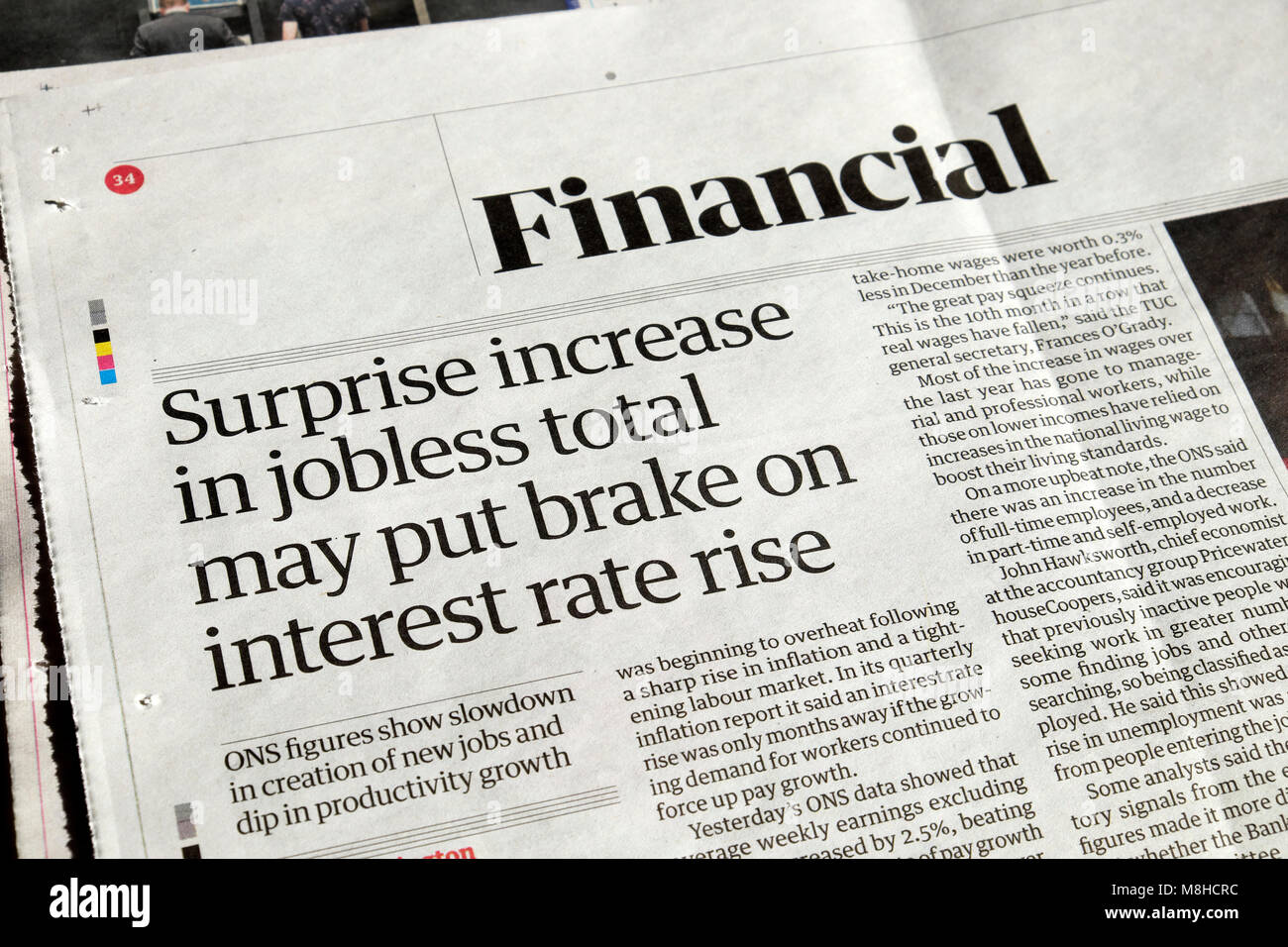 Guardian newspaper article Financial headlines  'Surprise increase in jobless total may put brake on interest - Stock Image