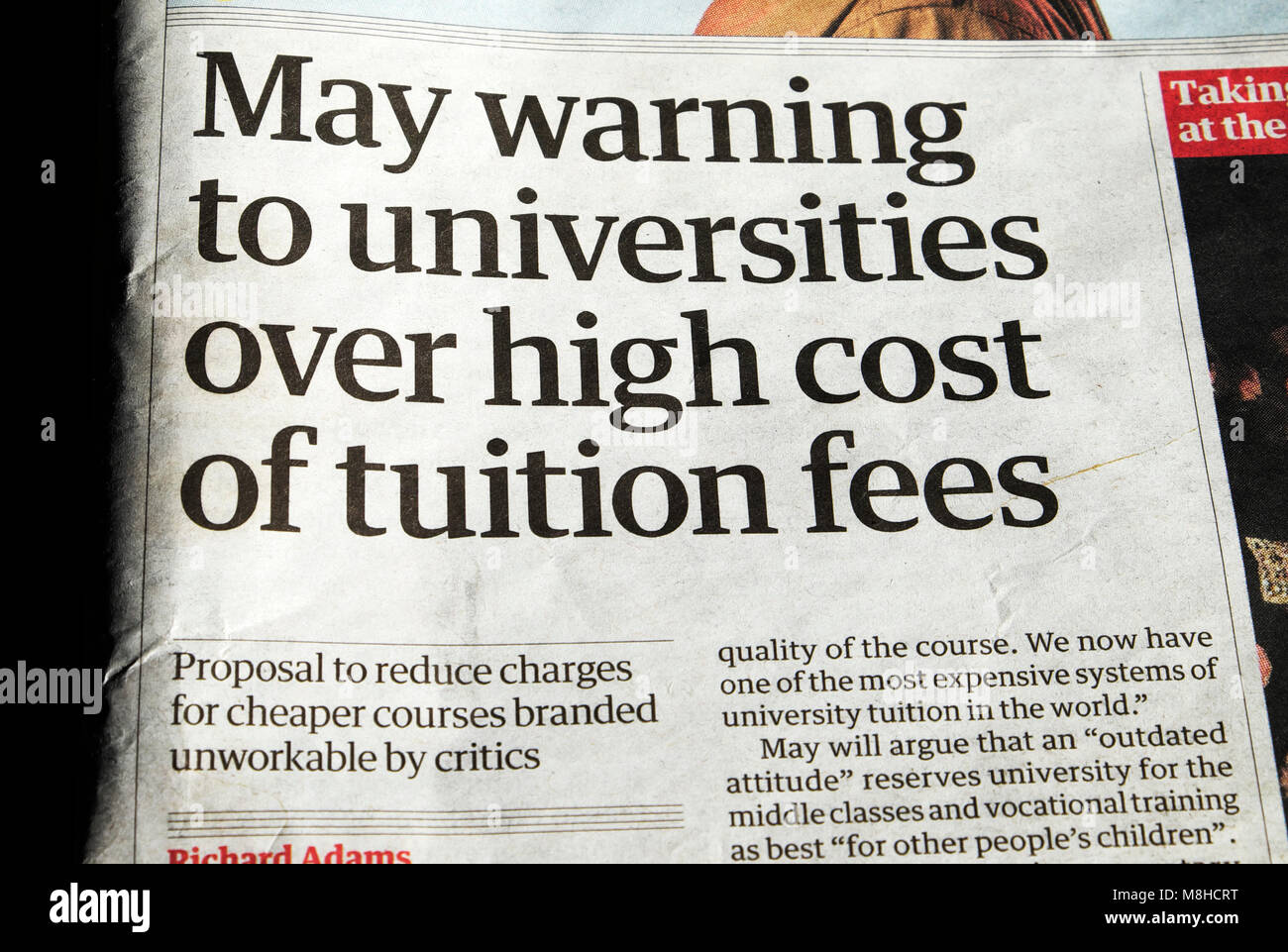 Guardian newspaper education article 'May warning to universities over high cost of tuition fees' 19 February - Stock Image