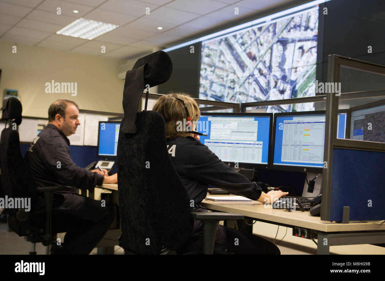 Police officers control the emergency calls from their control area inside main local police headquarter in palma - Stock Image