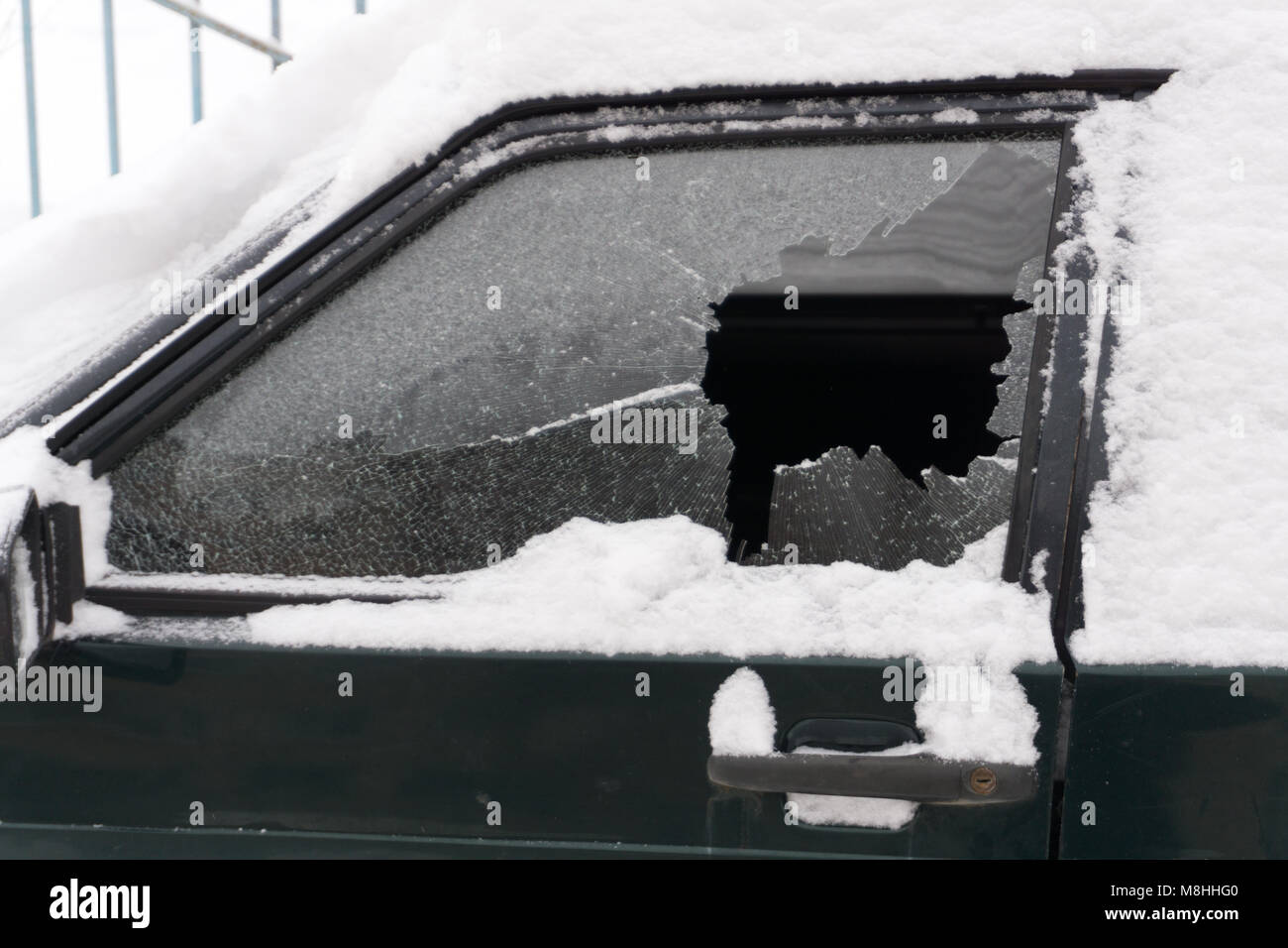 broken old white car door closeup on the street - Stock Image