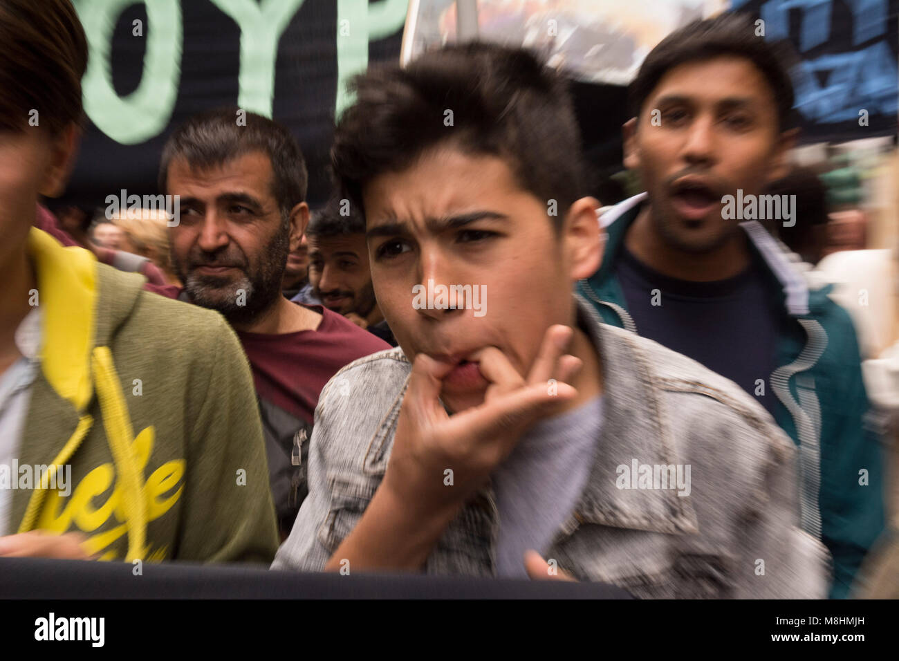 Refugees and migrants protest against EU's migration policy and demand open borders. - Stock Image