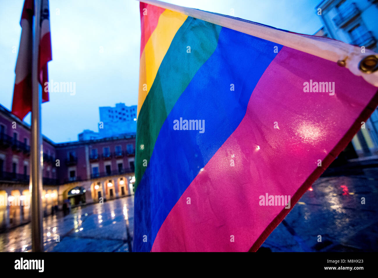 Gijon, Spain. 17th March, 2018.  Rainbow flag during a demosntration for raising awareness of discrimination faced - Stock Image