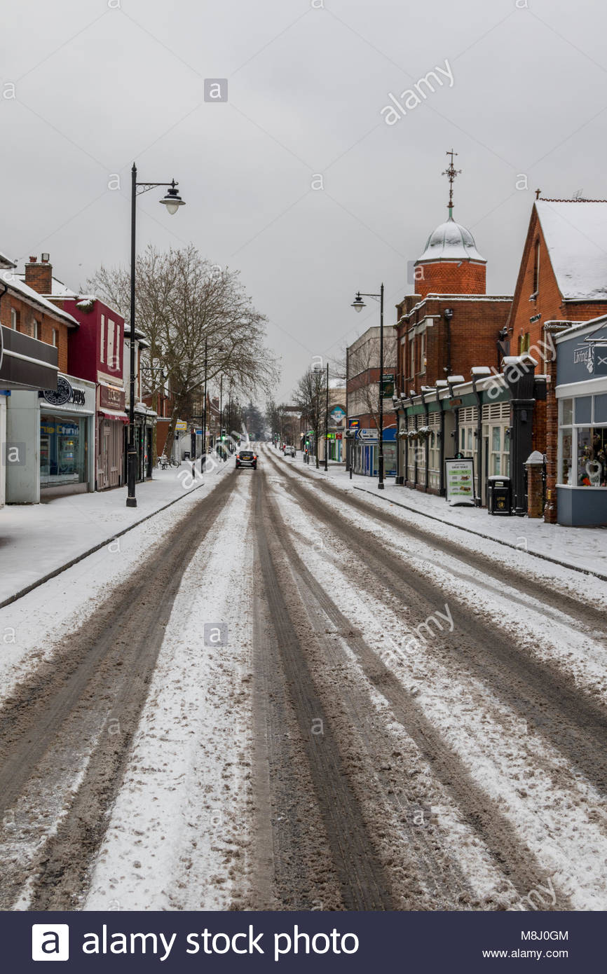 Fleet, Hampshire, UK. 18th March 2018. The return of the 'beast from the east' brought a covering of snow - Stock Image