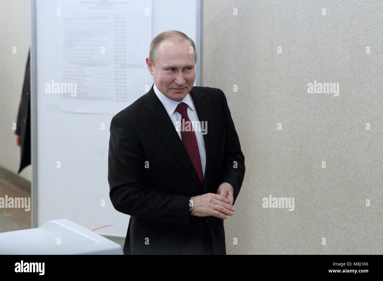Moscow. 18th Mar, 2018. Russian President Vladimir Putin leaves a polling station after voting in Moscow March 18, Stock Photo