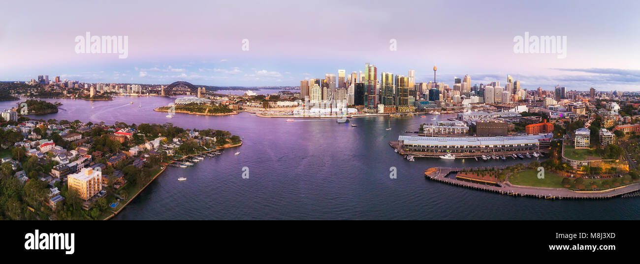 Colourful sunset over Sydney city CBD landmarks from North Sydney through Barangaroo to Darling harbour in aerial - Stock Image