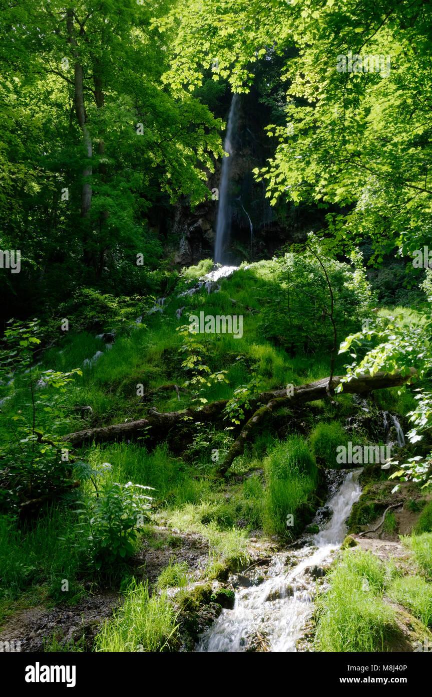 Waterfall (Uracher Wasserfall) near Bad Urach, northern eedge of the Swabian Alps, Baden-Württermberg, Germany - Stock Image