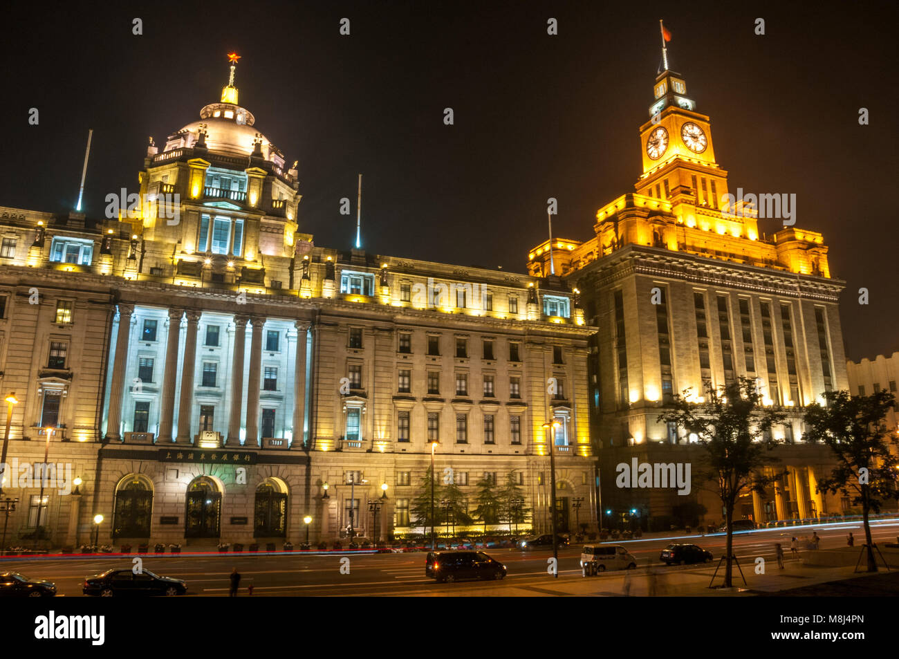 The former Hong Kong & Shanghai Bank and Custom House buildings on Shanghai's historic Bund seen at night from - Stock Image