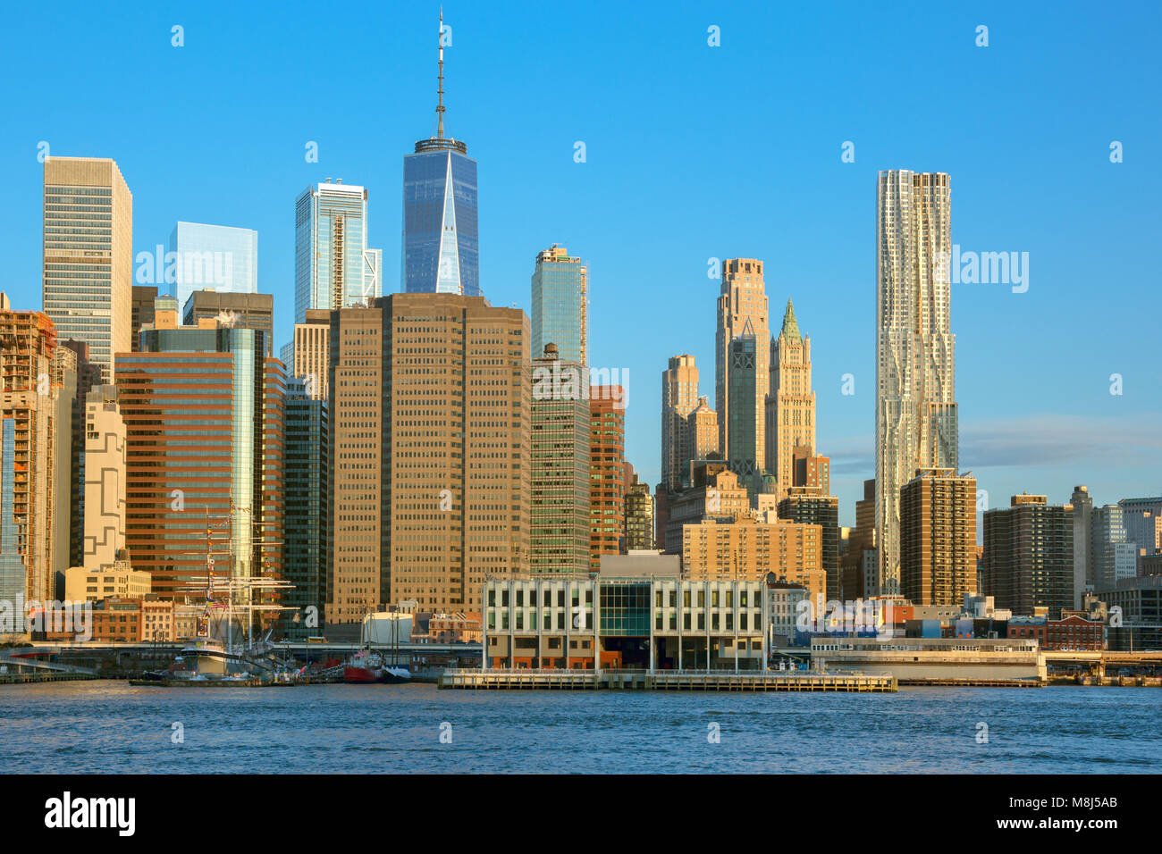 DOWNTOWN SKYLINE EAST RIVER MANHATTAN NEW YORK CITY USA Stock Photo