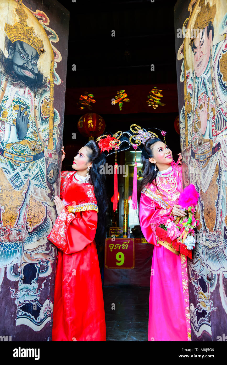Chachoengsao, Thailand - July 14, 2013 : Beautiful women with traditional chinese dress at Chinese shrine door with - Stock Image
