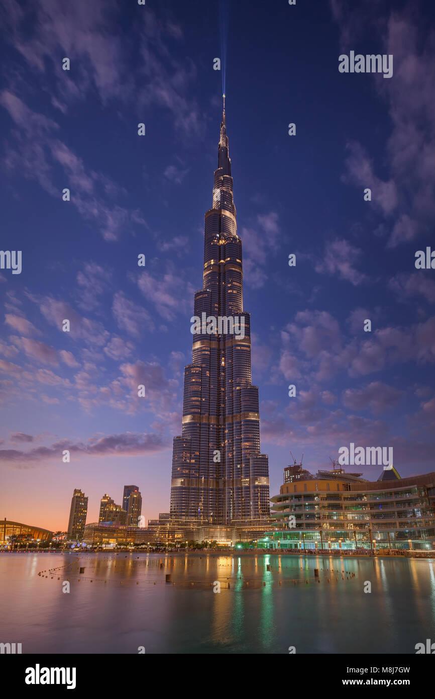 Futuristic decoration on famous Burj Khalifa tower at beautiful sunset - Stock Image