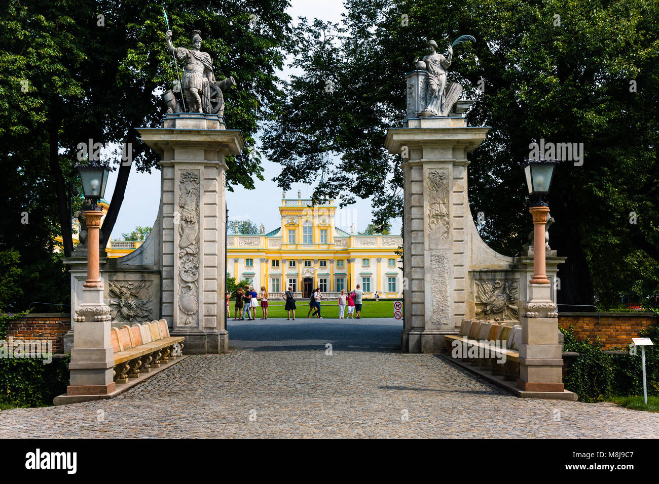 WARSAW, POLAND - JULY 26, 2014:  Tourists at the main entrance of the Wilanow Royal Palace park Stock Photo