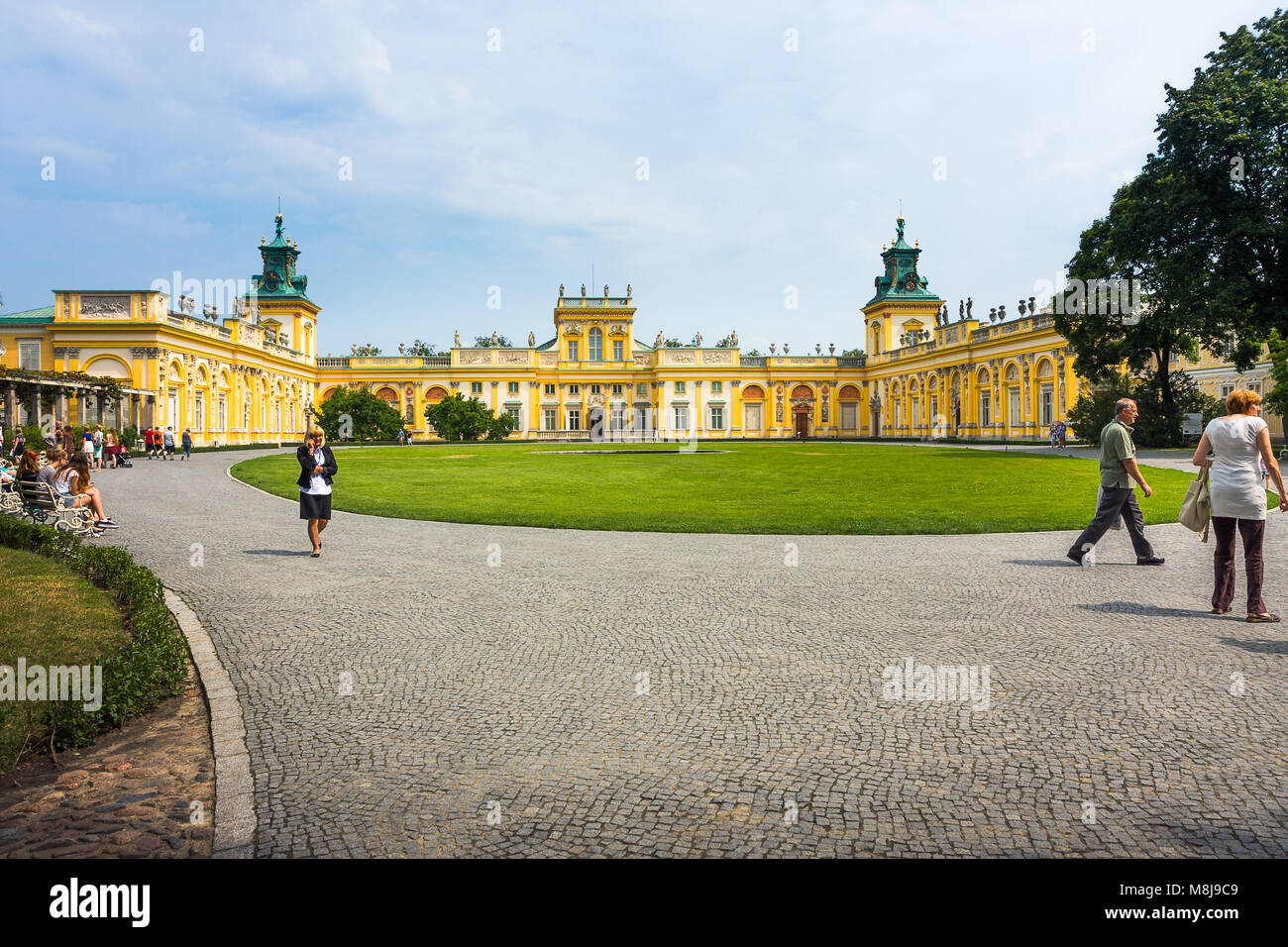 WARSAW, POLAND - JULY 26, 2014:  Wilanow Royal Palace main yard with tourists - Stock Image