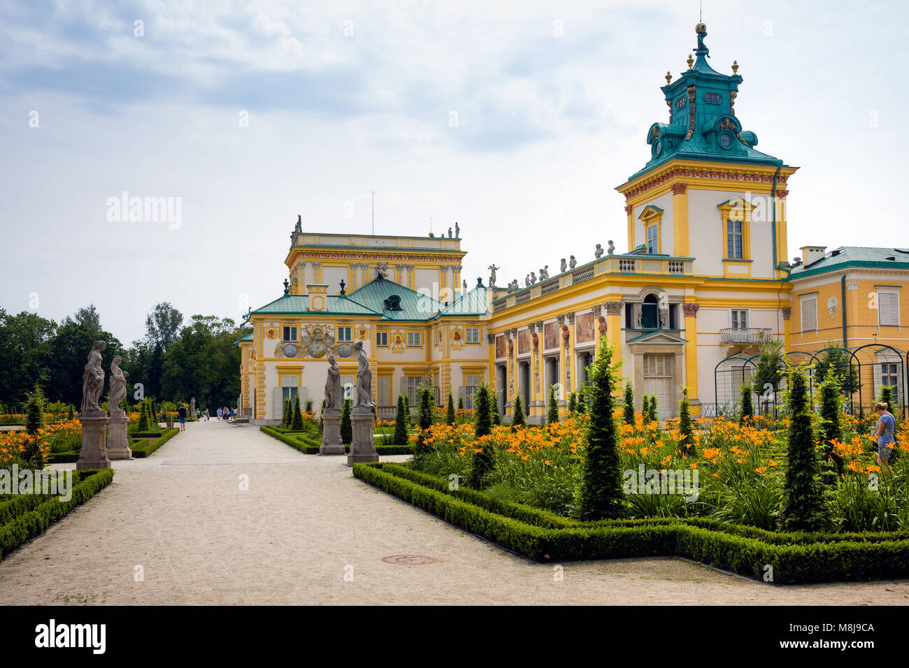 WARSAW, POLAND - JULY 26, 2014: Wilanow Royal Palace gardens and ancient statues Stock Photo