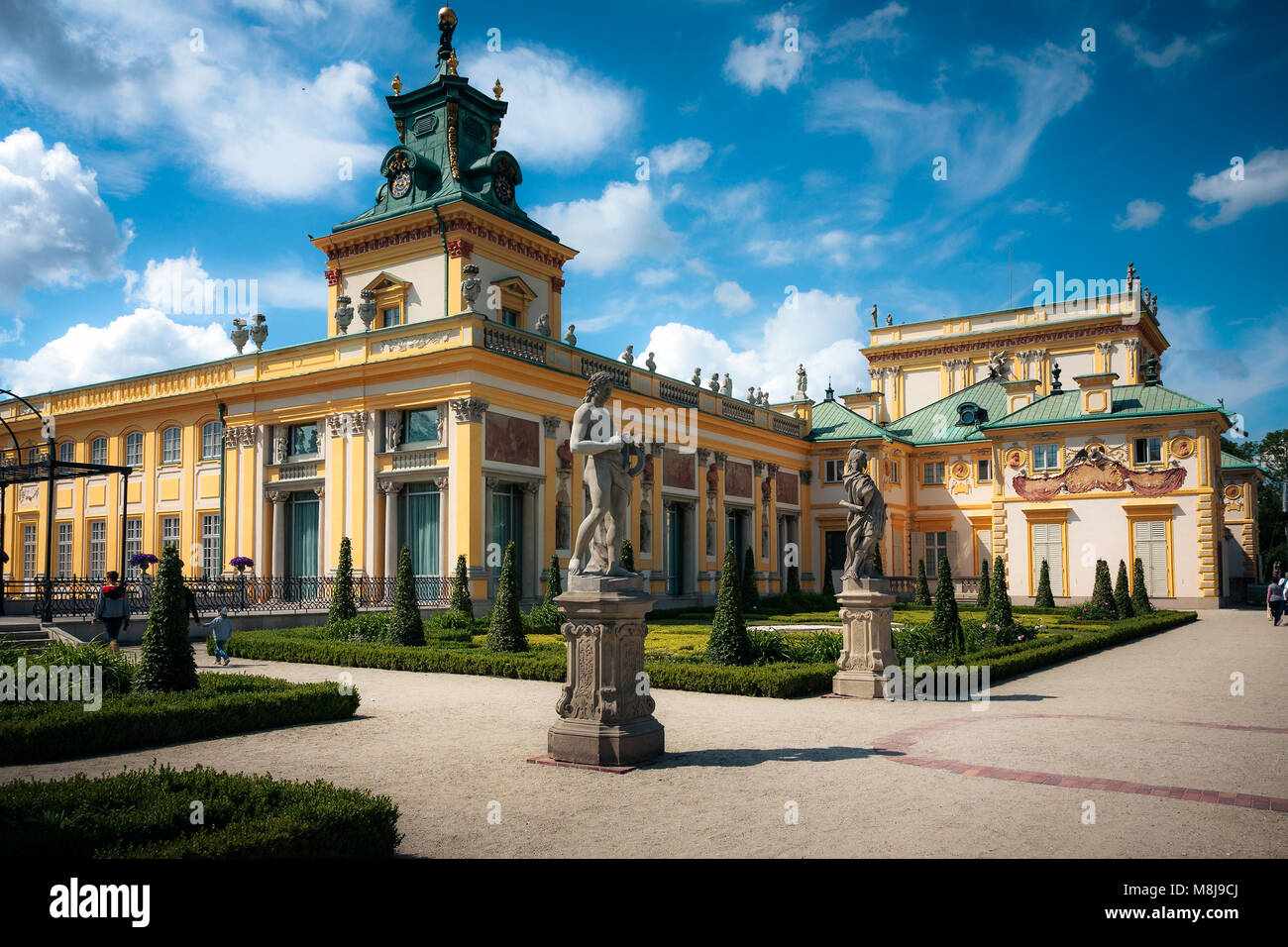 WARSAW, POLAND - JUNE 21, 2015: Wilanow Royal Palace gardens and ancient statues Stock Photo