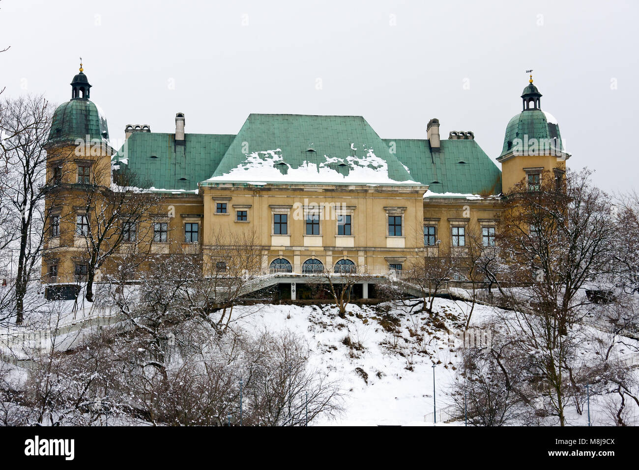 WARSAW CITY, POLAND - MARCH 15, 2010: Baroque-Neoclassical Ujazdow Castle in winter time, between Ujazdow Park and Stock Photo
