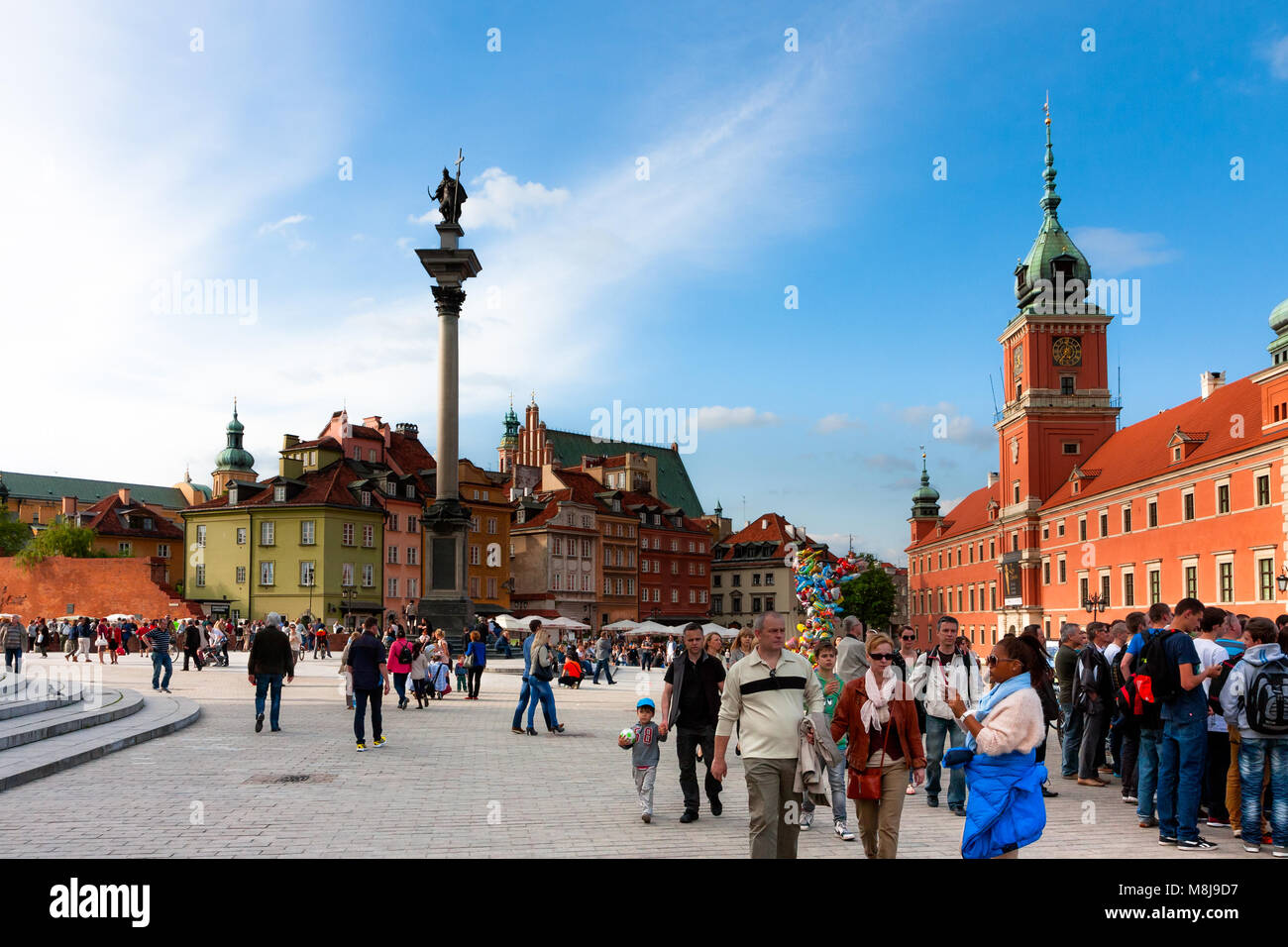 Castle Square full of tourists and Sigismund's Column, major tourist attractions of Warsaw. POLAND - MAY 18, 2014: Stock Photo