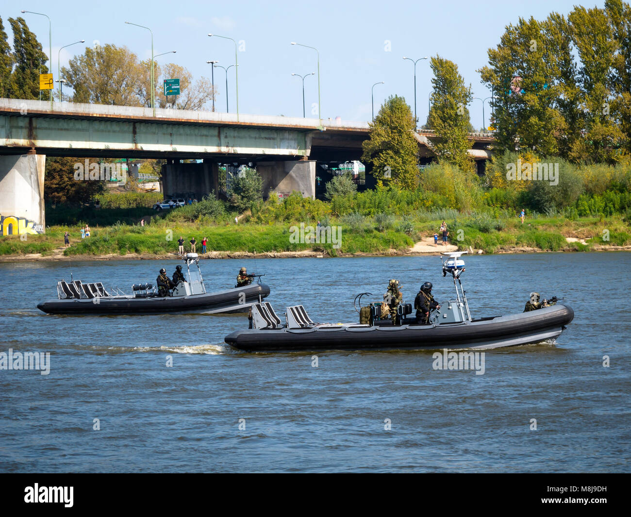 Polish GROM Special Forces preparing for boarding a boat with terrorists from pontoons on the Vistula River. WARSAW, Stock Photo