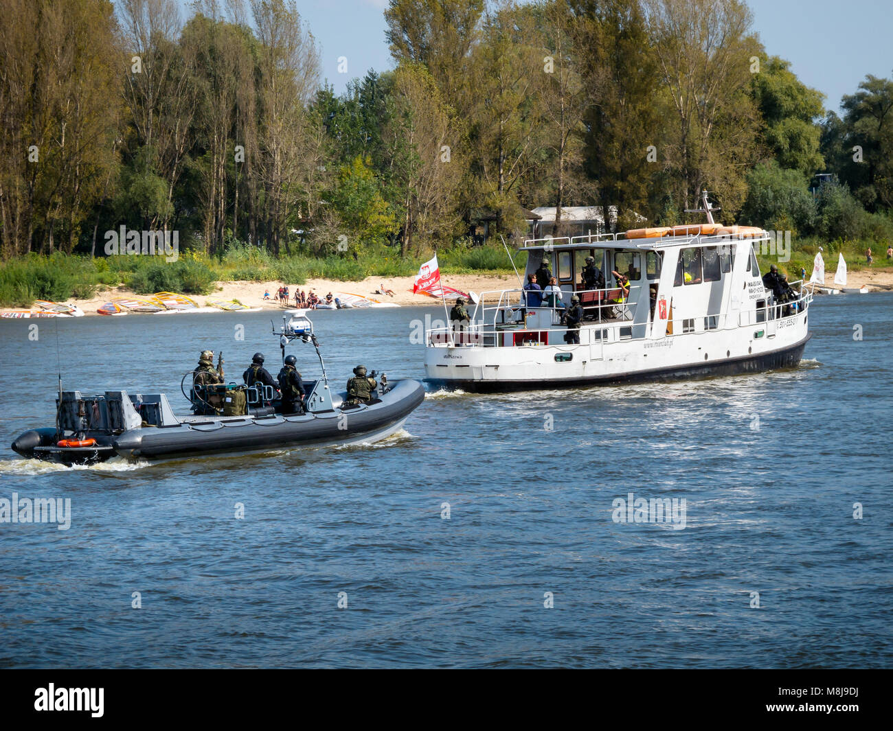 GROM Special Forces preparing for boarding a boat with terrorists from pontoons on the Vistula River. WARSAW, POLAND Stock Photo