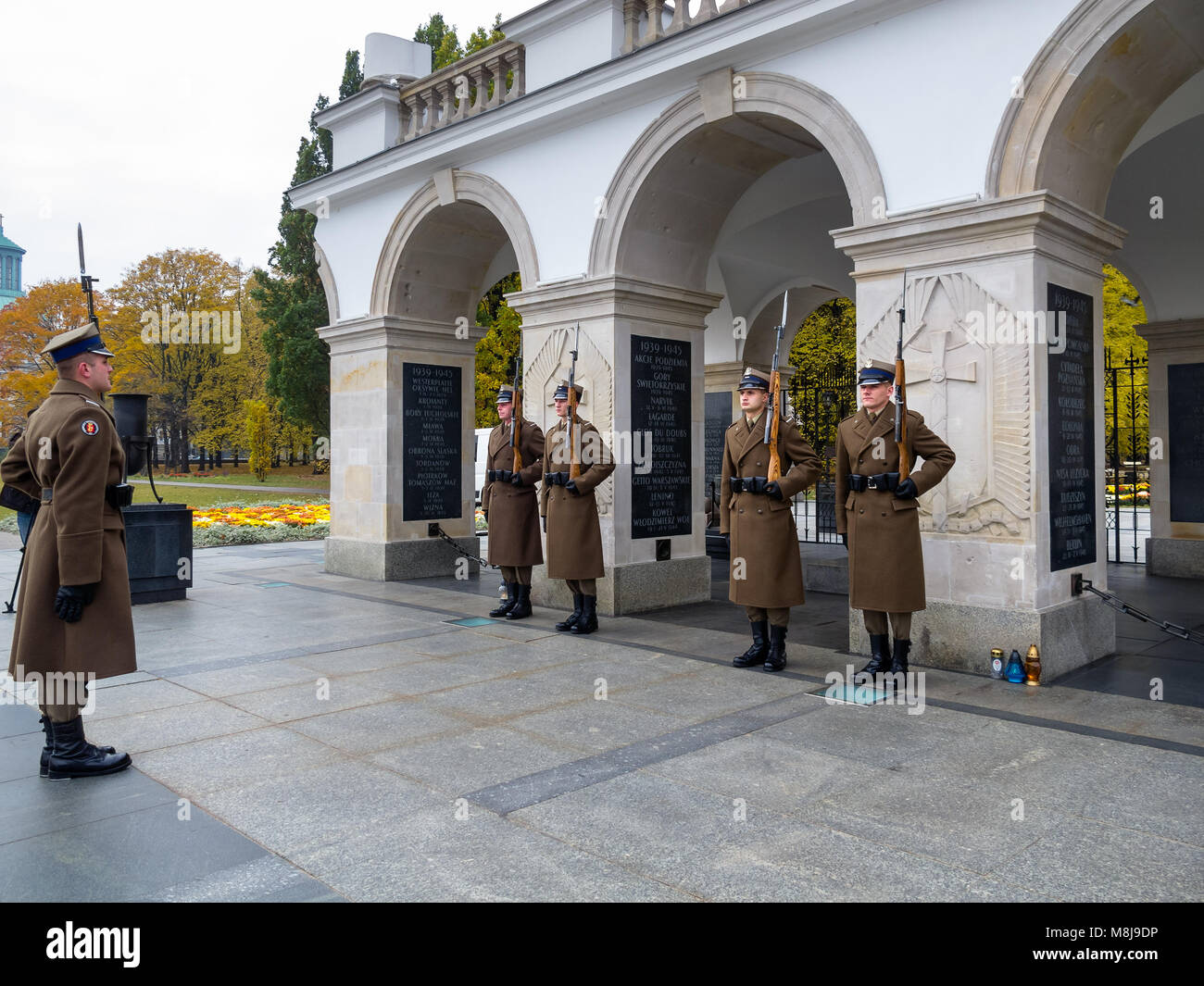 Tomb of the Unknown Soldier and the Honor Guard, since 1925. Part of the Saxon Palace at Pilsudski Square. WARSAW, Stock Photo
