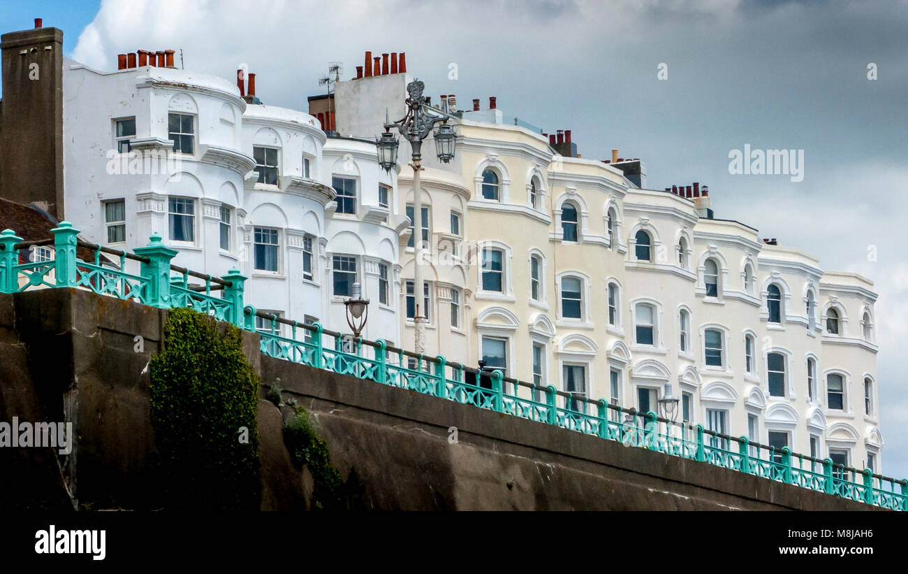 Row of classic grand terraced Victorian seafront homes overlooking Madeira Drive in Brighton Stock Photo