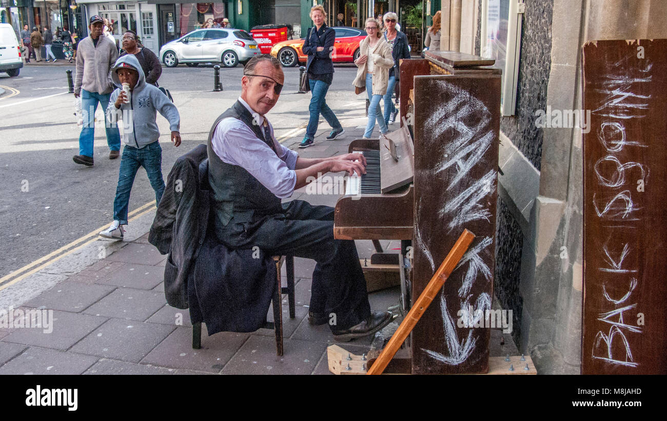 An extremely  talented pianist playing his mobile upright piano in The Lanes of Brighton Stock Photo