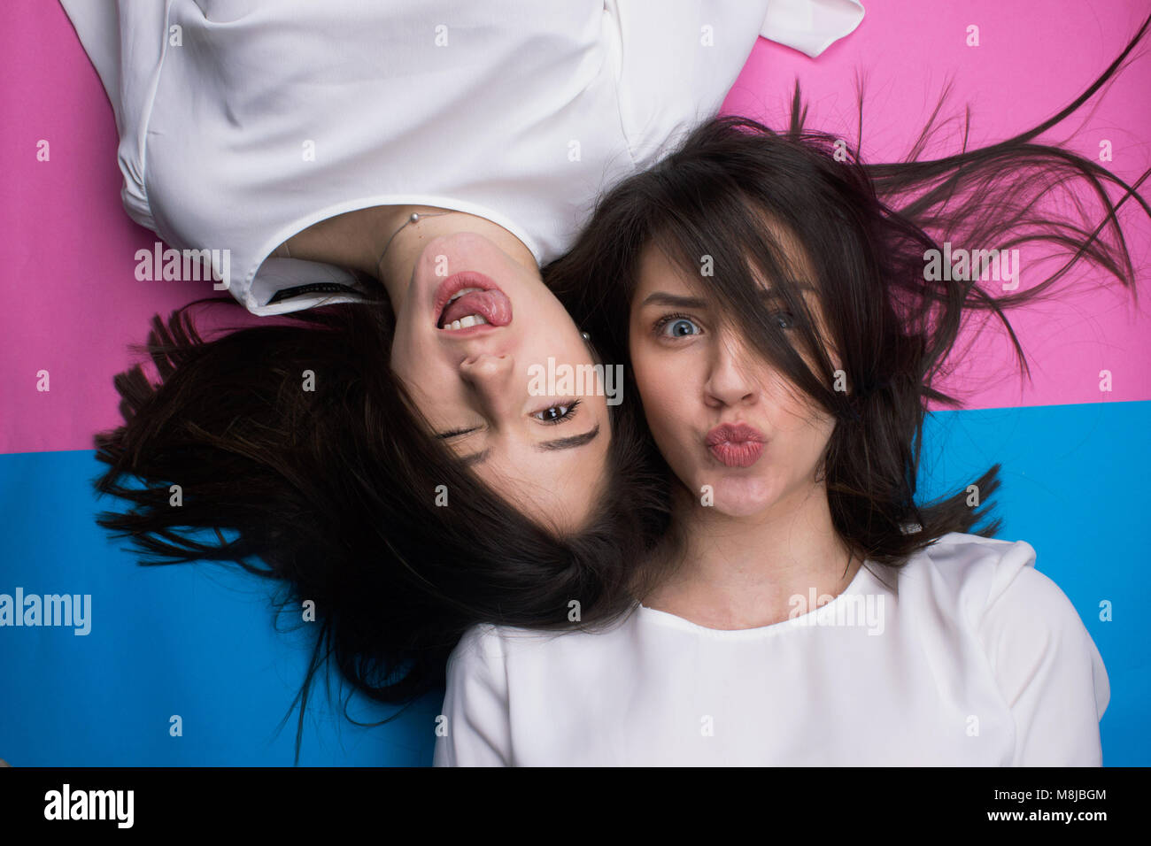 two young beautiful girls have a fun isolated - Stock Image