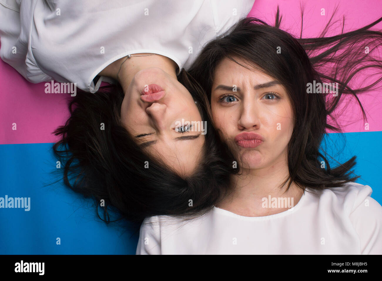 young attractive girls making faces at camera - Stock Image